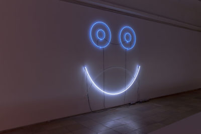 "Adele Röder Installation view Haus der Kunst COMCORRÖDER Mask Totem (Part Four) C-Component and Umlaut Neon Lights (Neon / Argon / Krypton / Mercury), 2010/2015 From ""O L Y M P I A, or: Message from the Dark Room"" Series. Photo: Maximilian Geuter"